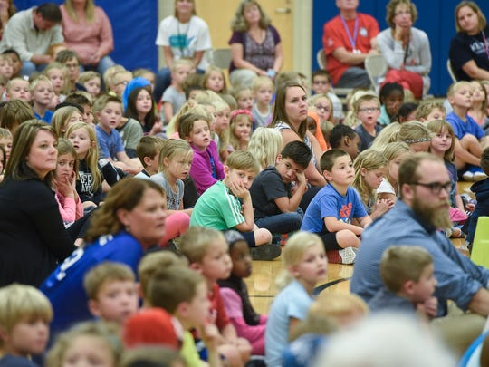 Students listen to speakers during an assembly in September 2017 at Kennedy Community School in St. Joseph.