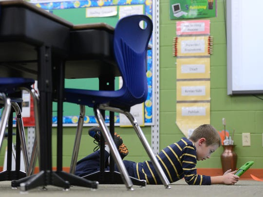 Tyson Dappern uses an iPad to play a game called 'Math Ninja' during an individual work time in Stephanie Clarke's second grade class at Hemlock Creek Elementary School.