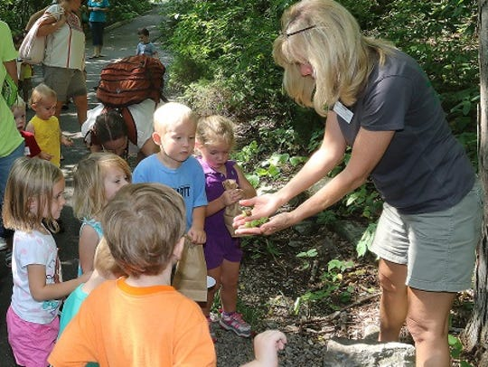 Denise Longe of the Wilderness Station shows kids at
