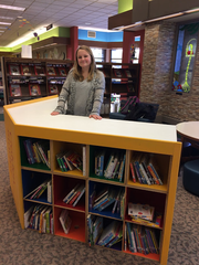 Brookfield resident and Girl Scout Maggie Conlon, 15, stands next to her display for the Brookfield Public Library. For her Take Action Project she made a more attractive bookcase to appeal to children.