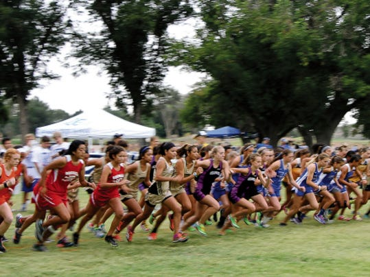 The girls varsity cross country race gets off to a quick start Saturday at the Cavemen Invitational at the Carlsbad Municipal Beach Park.