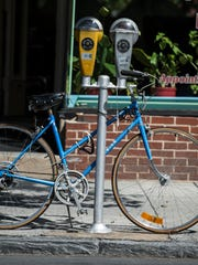 A bike is locked to a parking meter in the 500 block