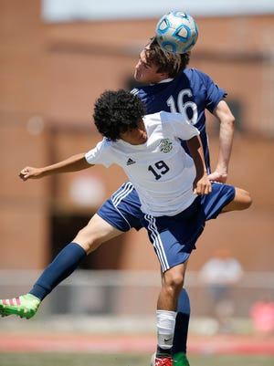 Juan Diego's Alex Saunders and Snow Canyon's Axel Vichi compete in the 3A championship game in Draper Saturday, May 14, 2016. Juan Diego won 1-0.