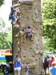 A climbing wall was one of the many attractions at the Walleye Weekend festival Friday through Sunday in Fond du Lac.