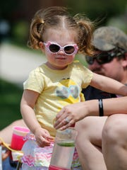 Emma Goldapske of North Fond du Lac watches The North Fondy Fest parade as it wound through village streets Saturday.