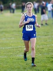 Winnebago Lutheran's Sarah Niehueser runs during a meet earlier this year.