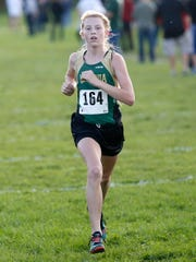 Laconia Cyna Madigan runs during a meet earlier this