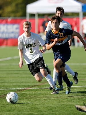Green Bay Preble High School's Zach Woelfel runs for the ball against Marquette University's Thomas Bruneau in their WIAA Division 1 state championship game played at Uihlein Soccer Park in Milwaukee Saturday November 5, 2016. Marquette won the match up 1-0.