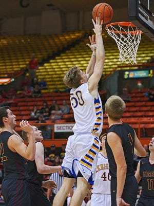 O'Gorman's JP Costello (50) goes up for a shot during a 2017 SDHSAA Class AA State Boys Basketball quarterfinal game against Harrisburg Thursday, March 16, 2017, at Rushmore Plaza Civic Center in Rapid City.