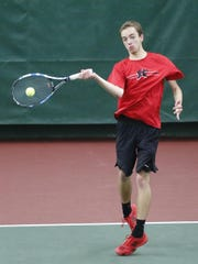 Alex Alt of Kimberly hits a return during the Division 1 singles state tournament Saturday.