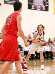 Waupun High School boys basketball's Reece Homan looks