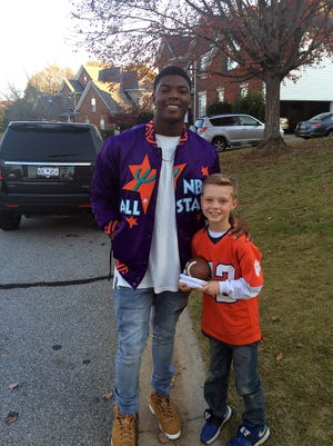 Clemson quarterback Zerrick Cooper and Tigers fan Will Swanson pose for a picture after Cooper's surprise visit on Thanksgiving Day, November 23, 2017.
