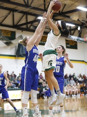 Heather Pearson, left, reached double figures in both of Amherst girls basketball games during the Sentry Classic this past week at the University of Wisconsin-Stevens Point.