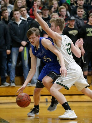 Winnebago Lutheran Academy boys basketball's Gabe Pruss drives in under the basket while being defended by Laconia High School's Joe Chiero during their game Friday January 19, 2018 in Rosendale. Doug Raflik/USA TODAY NETWORK-Wisconsin