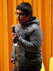 Theisen Middle School eighth-grader Angel Reyes spells
