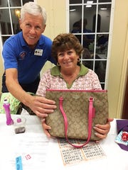 On Feb. 1, the Knights of Columbus San Marco Council #6344 hosted a bingo fundraiser in the San Marco Parish Center. Above, Coach bag winner Karen Meissel of New York.