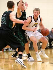 Waupun's Marcus Domask drives against Kettle Moraine Lutheran on Feb. 8 in Waupun.