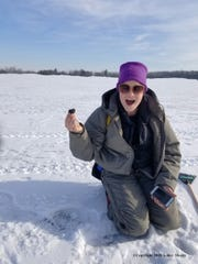 Ashley Moritz holds up a meteorite she found on a Hamburg