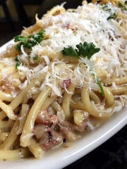 Bucatini carbonara made the Italian way with pancetta,