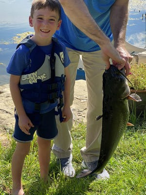 Six-year-old Austin Mann, of Salina, caught this 12-pound, 26-inch catfish all by himself while fishing at Sunflower Lake. He released the fish in hopes of catching it again. To submit your own photo to run in the paper, email jrouse@cjonline.com with your name and the name of the person in the photo, their age, what city they'e from and any backstory about the photo you wish to include. Photos will also be posted online at CJOnline.com and Facebook.com/TCJOutdoors.