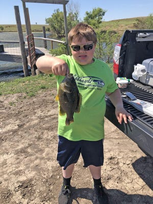 Zane Sorensen, of Garden City, caught this 12-inch green sunfish in a farm pond near Utica. To submit a hunting or fishing photo to run in the paper, send an email to jrouse@cjonline.com with your name and the name and age of the person in the photo, what city you're from and any backstory about the photo you wish to include (where the fish was caught, what you were using, etc.).