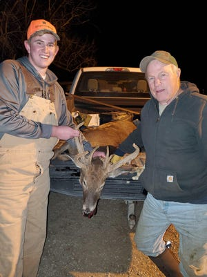 From left, 18-year-old Hayden High senior Aidan Colter and his father, Keith, hold up the unique rack of a buck Aidan shot on his own on the opening day of rifle season in southwest Shawnee County. The deer's rack was still in full velvet and was a nontypical.
