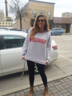 Brynna Marnocha gets ready to leave downtown De Pere on Friday morning, April 3, for Indianapolis, site of the NCAA men's basketball Final Four. Marnocha, a De Pere HIgh School graduate, is wearing the gray Wisconsin sweatshirt she plans to wear to the Badgers' semifinal game against Kentucky on Saturday night. The sweatshirt belonged to her late grandfather, who was a big Badgers fan.