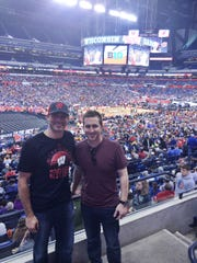 Green Bay-area friends Logan Krueger, left, and Chett Zeise stand inside Lucas Oil Stadium in Indianapolis as the Wisconsin Badgers hold their Final Four practice Friday afternoon, April 3. Krueger is a graduate of Denmark High School, and Zeise is an alum of Green Bay Notre Dame.