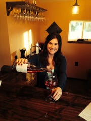 Winemaker Aurora Cória-Day pours a glass of 2013 Cória Estates Rosé of Pinot Noir at the new tasting room.