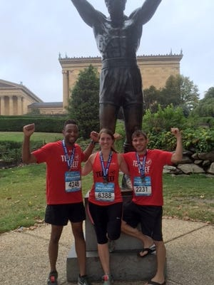 Team Beef runners at the 'Rocky' statue in Philadelphia, PA.)