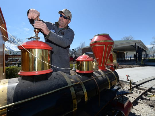 City of Green Bay Parks and Recreation Department worker Mark Des Jardin works on the whistle on top of the Centennial, the new locomotive for the railroad at Bay Beach Amusement Park.