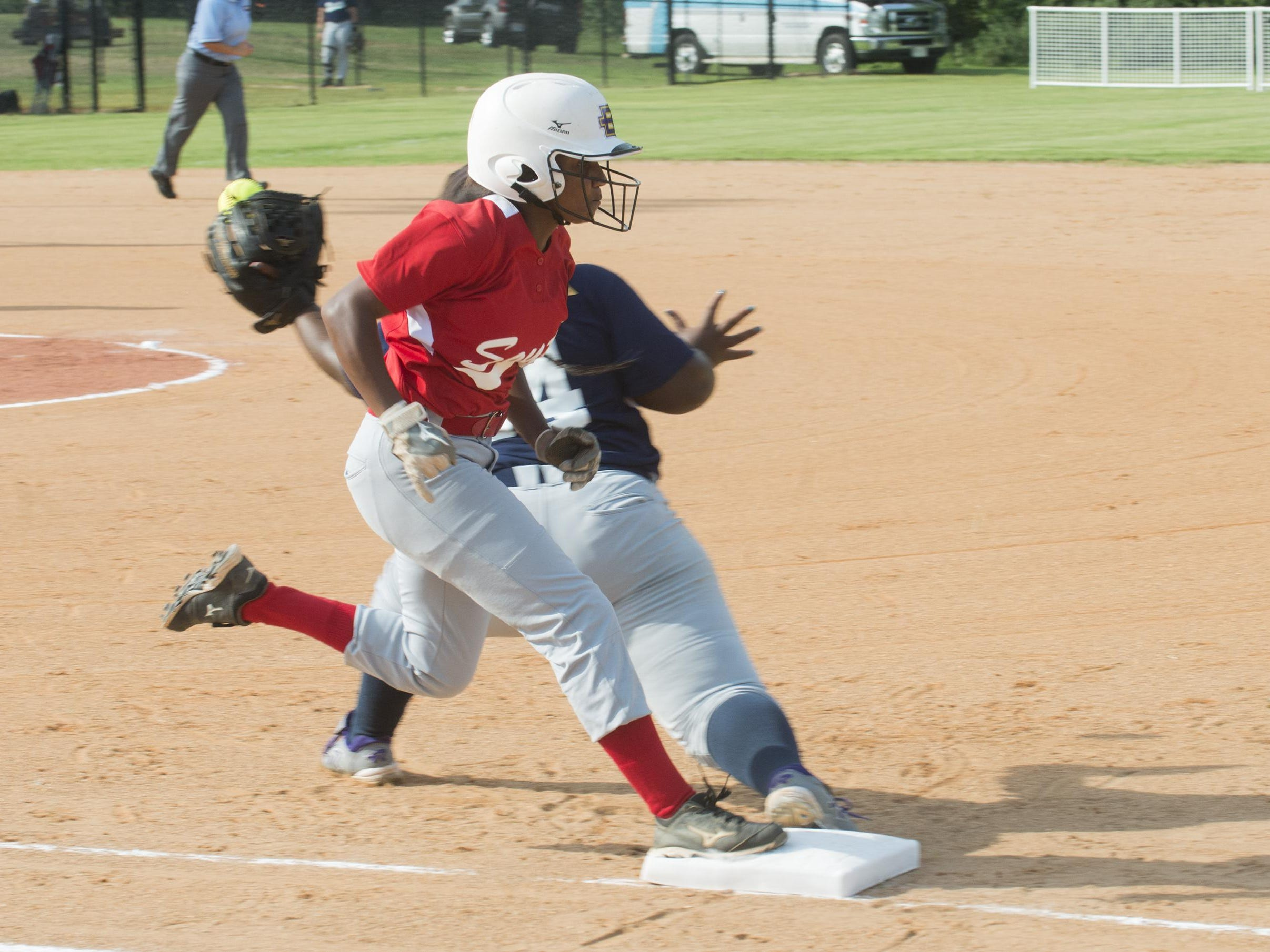 Elmore County player Elissa Brown of the South All-Stars team beats a throw to be safe at first. The South All-Stars team took a 4-3 win in game 1 over the North team on Tuesday, July 21, 2015.