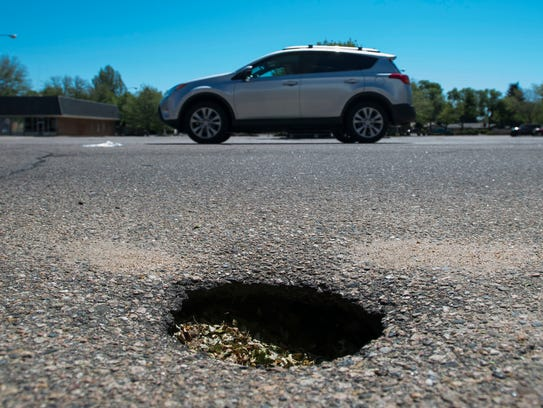 A deep pothole lurks in front of the building once