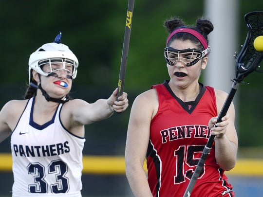 Hustle is just one trait coaches and teammates love about Pittsford junior attack Ellie Mooney, left.