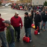 Madison, NJ- November 1, 2012--Residents line up at Madison Shell  to fill up cars and gas cans as locals continue the recovery process after Hurricane Sandy devastated the eastern seaboard. Bob Karp/Staff Photographer/DAILY RECORD