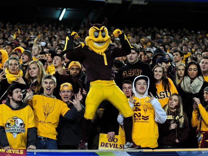 Arizona State Sun Devils mascot Sparky cheers with fans during the game against the Stanford Cardinal at Sun Devil Stadium.
