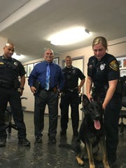 Officer Jamie Buffone and her partner, Rex, posed for pictures after the K-9 was sworn in June 2016.