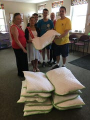 The youth of the V.F.W. Burns Post 388 Auxiliary members constructed 16 dog beds that were donated to New Life Pet Adoption Center in Marathon, as a project for the youth. Pictured are Deb Spatz, V.F.W. Auxiliary senior vice president, Tayler Wendt, V.F.W. Burns Post 388 Buddy Poppy Princess, Tyler Wendt, grandson of an Auxiliary member, Jacob Nowak, another grandson of an Auxiliary member, Kathy Miller, V.F.W. Auxiliary Americanism chairperson, and Brian Wanta, New Life Pet Adoption Center employee.