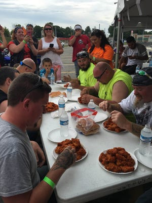 Participants prepare for a hot wings-eating contest Sunday during an AO Moto benefit event for Riley Hospital for Children.