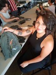 Phoenix fashion designer Leonor Aispuro shows off part