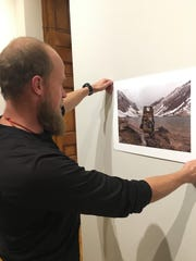 """Steve Wolff hangs his photo titled """"Enjoying the View,"""""""
