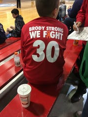 Members of the New Palestine travel basketball league wore shooting shirts to honor Brody Stephens this season.