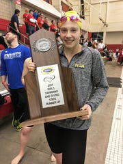 Notre Dame junior Sophie Skinner with the state runner-up trophy during the KHSAA state swimming and diving meet Feb. 25, 2017 at the University of Louisville.