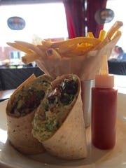 Chicken Avocado Salad Wrap with chicken, hickory-smoked bacon crumbles, lettuce, tomato and avocado mayo.