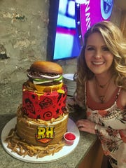 Tara Beam poses with a cake she ordered from Crooked