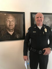 Palm Springs Police Dept. Capt. Henk Peeters poses next to his portrait.