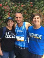 Dr. Shawn Allen with her sons Tyler (center) and Christopher at a UCLA track meet in 2016.