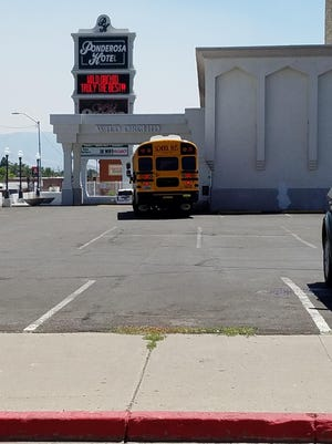 A photo posted on social media shows a Washoe County School District school bus parked near the Wild Orchid strip club. A statement explained the driver was eating lunch at Newman's Deli.