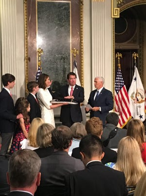 Bill Hagerty of Nashville is sworn in as the 42nd U.S. ambassador to Japan during a ceremony Thursday, July 27, in Washington, D.C. Vice President Mike Pence administered the oath. Hagerty is surrounded by his wife, Chrissy, and their four children.