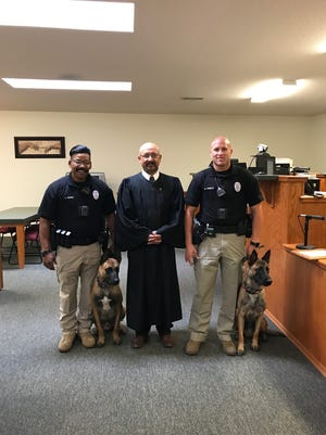 Carlsbad Police Department canine officers Alf and Aris were sworn in Wednesday, Sept. 13, 2017. The dogs have been assigned to Cpls. Norman Bowie (left) and Rory Preece (right). Pictured at center is Magistrate Judge Henry Castaneda.